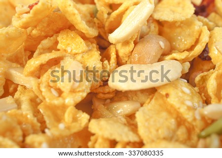 Closed up Pattern/Texture of Cornflakes and nuts (peanuts, cashew nuts, sunflower seeds), Healthy snack concept, selective focus