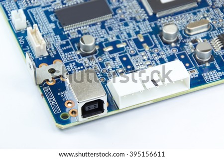 Closed up printed circuit board with electronics components - stock photo