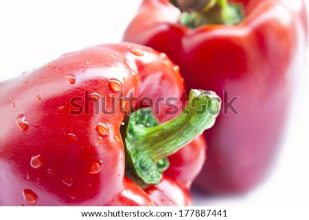 Closed-up red fresh sweet pepper isolated on white background  - stock photo