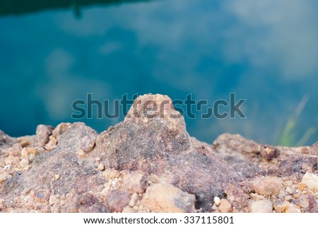 Closed-up soil of Hang-dong Grand canyon in north of Thailand. Reservoir from old soil mine with the river background. - stock photo