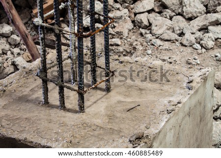 closed up steel bars reinforcement column on concrete foundation