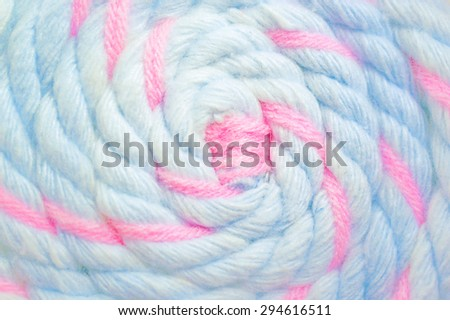 Closed up Texture of Yarn Lollipop in Pastel Blue and Pink, Selective Focus, Blur Background, Shallow depth of field [Vivid Bright Collection] - stock photo