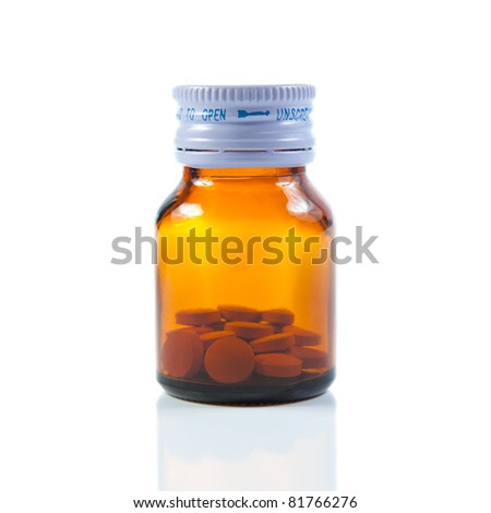 Closed vial of pills. Isolated on white background - stock photo