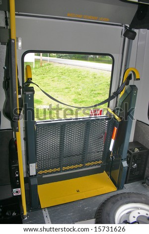 Closed wheelchair lift on a bus - stock photo