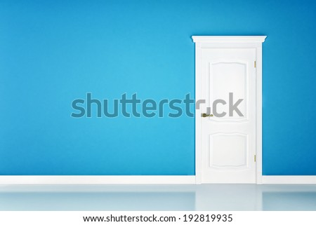 Closed white door on blue wall background - stock photo