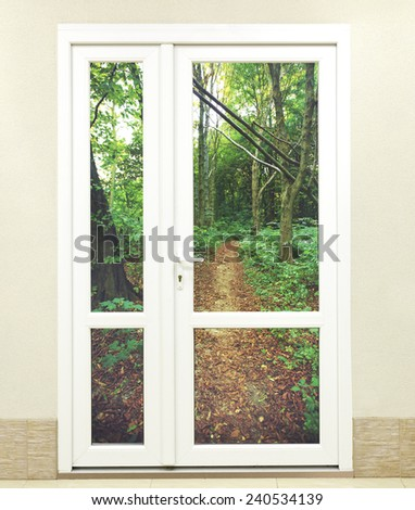 Closed White Door on Wall and forest outdoor