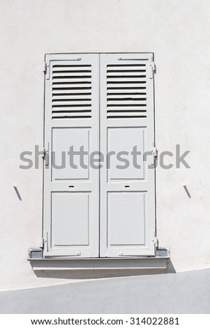 Closed white shutters near Paris, France - stock photo