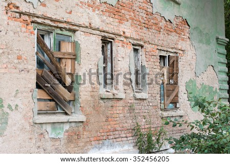 closed windows in an abandoned city - stock photo