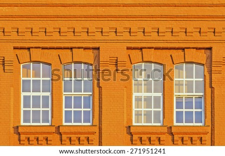 Closed windows in the old building at sunset time. - stock photo