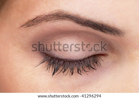 Closed woman eye with makeup. Macro shot. - stock photo