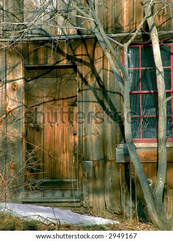 closed wooden door at old building in the winter, leverett, massachusetts