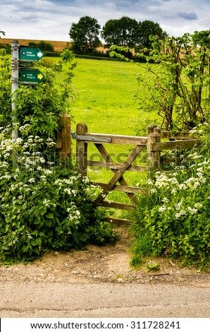 closed wooden gate leading to the pasture - stock photo