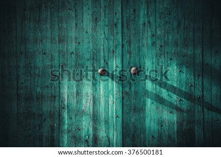 Closed wooden textured doorway. Full frame wooden gate background - stock photo