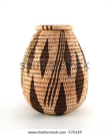 Closed woven basket from Botswana made from the fiber of the Mokola palm tree. - stock photo