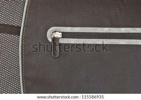 Closed zip on a modern nylon laptop bag - stock photo