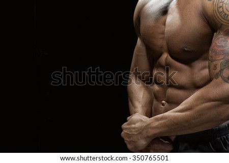 Closer look. Cropped closeup of a stunning hot toned male torso - stock photo