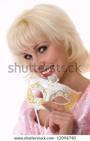 Closeup. A doll-looking woman under the venetian mask
