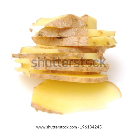 closeup a stack of sliced ginger on white
