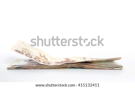 Closeup a stack  of Thailand money isolated on white background. - stock photo