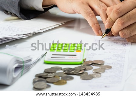 Closeup accountant checking bill on the desk - stock photo