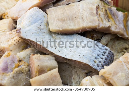 Closeup and focus on a portion of freshly dried and preserved salted fish, a delicacy among Asians - stock photo