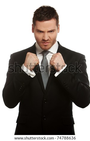 Closeup angry businessman holding his fists into camera. Isolated on white background - stock photo