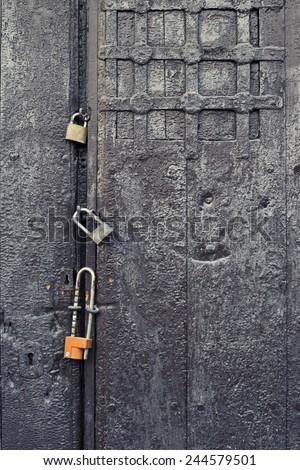 Closeup antique wooden door, three lock - stock photo