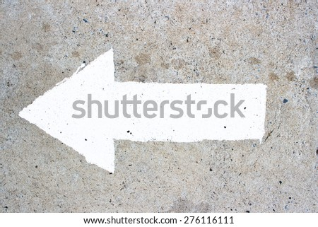 closeup arrow symbol on concrete road for input some message - stock photo