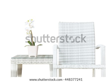 Closeup artificial plant with white orchid flower on pink flower pot on wood weave table with wood weave chair isolated on white background , beautiful interior in relaxation concept - stock photo