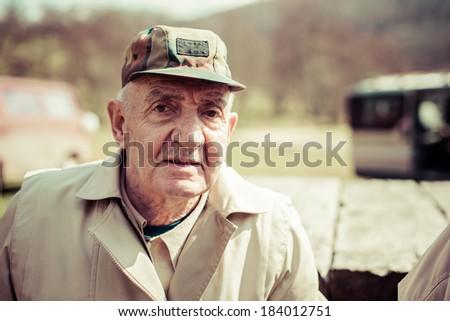 Closeup artistic photo of aged man - stock photo