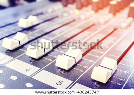Closeup audio mixer slider control in the boardroom.Photo filters - stock photo