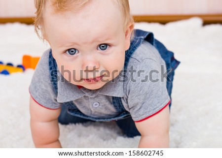 Closeup baby boy looking in a camera - stock photo