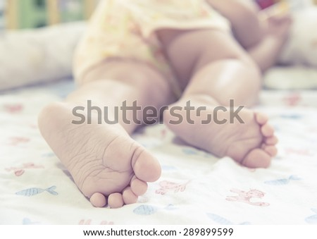 closeup baby feet  while sleeping   - stock photo