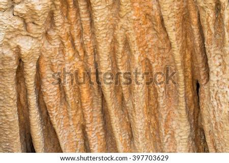 Closeup background texture cave stone curtain photo of stalactite cavern - stock photo