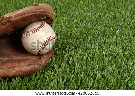 closeup baseball glove and ball - stock photo
