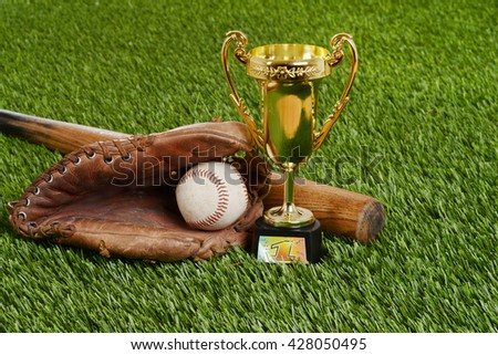 closeup baseball trophy with bat ball and glove - stock photo