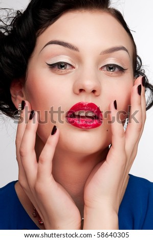 Closeup beautiful emotional glamour woman with red lips. Blue dress, black nails and beads. Vogue - stock photo