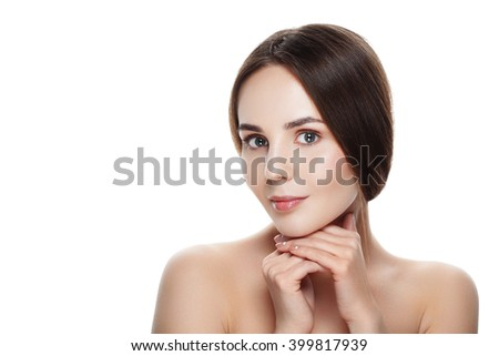 Closeup Beautiful face of young woman with clean fresh skin. Portrait woman touch her face by hands with beautiful blue eyes on white background. Beautiful woman with natural make-up.