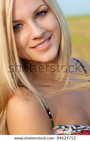 closeup beautiful woman face outdoors portrait - stock photo