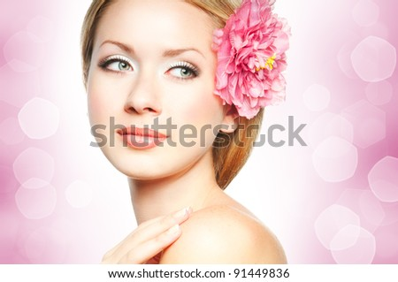 Closeup beautiful woman face with flower - stock photo