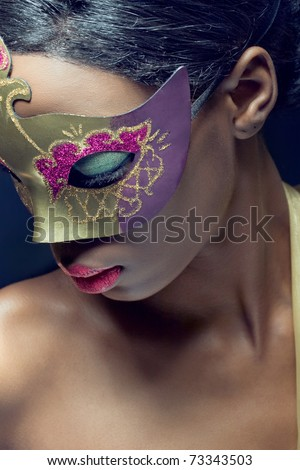 Closeup beauty portrait of a young black woman wearing mask - stock photo