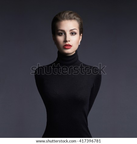 Closeup beauty portrait of a young brunette model in a black roll neck jumper. Sensual girl with short hair