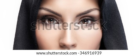Closeup beauty portrait of attractive young woman with beautiful brown eyes. Studio shot. - stock photo