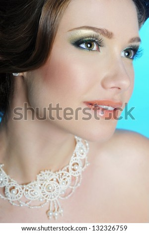 Closeup beauty portrait of bride with classic make up. Beautiful bride. Wedding decoration. Necklace of pearls