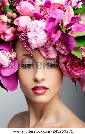 closeup beauty portrait with fresh flowers in hair - stock photo