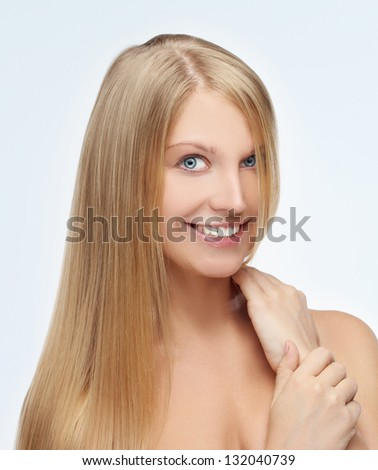 Closeup, beauty shot of adorable young woman with long blonde hair. - stock photo