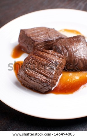 Closeup beef cut marinated and cooked in soy sauce - stock photo