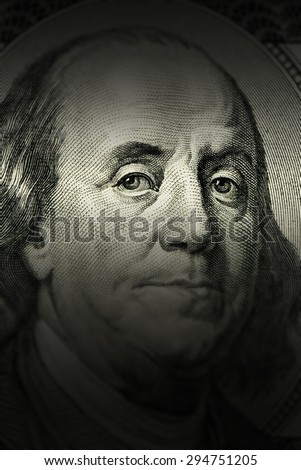 closeup Benjamin Franklin face on the US $100 dollar bill. - stock photo