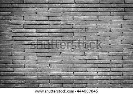 Closeup black and white brick wall texture for background. Grunge retro vintage of brick wall. Part of old brick wall for design with copy space for text or image. - stock photo