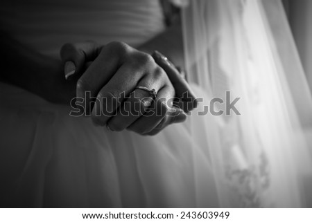 Closeup black and white photo of brides hands with beautiful manicure - stock photo